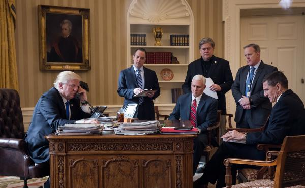 President Trump speaks on the phone in January with Russian President Vladimir Putin, joined by top White House figures Reince Priebus (from left), Vice President Pence, Steve Bannon, Sean Spicer and Michael Flynn. Only Pence remains.