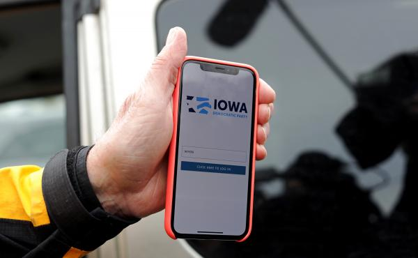 Des Moines City Councilman and a precinct chair Carl Voss shows the app that was used for caucus results reporting on his smartphone after he unsuccessfully attempted to drop off a caucus results packet from Precinct 55 at the Iowa Democratic Party headqu