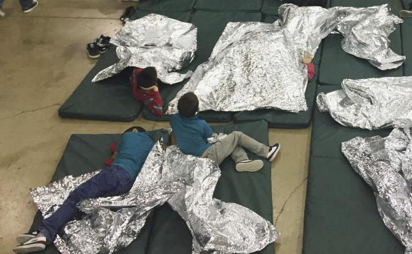 A photo provided by U.S. Customs and Border Protection shows the interior of a CBP facility in McAllen, Texas, on Sunday. Immigration officials have separated thousands of families who crossed the border illegally. Reporters taken on a tour of the facilit