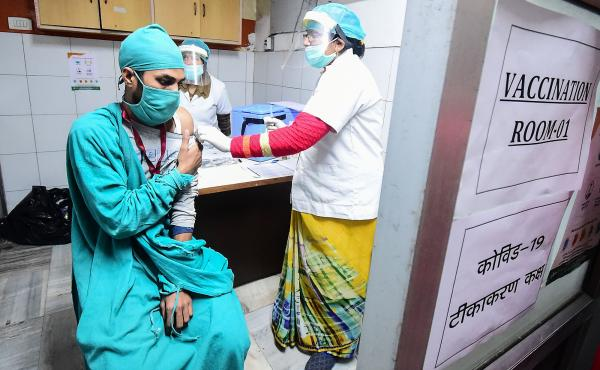 Volunteers and health officials hold a dry run for the coronavirus vaccine at a hospital in Allahabad, India. There's concern that drug patents will keep lower income countries from getting the doses they need in a timely fashion.