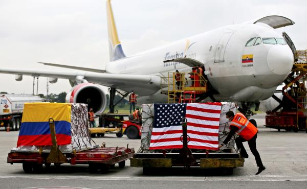 Containers of Moderna COVID-19 vaccine doses, donated by the United States, arrive in Bogota, Colombia, in July. The U.S. plans to send more than a billion vaccines abroad by September 2022.