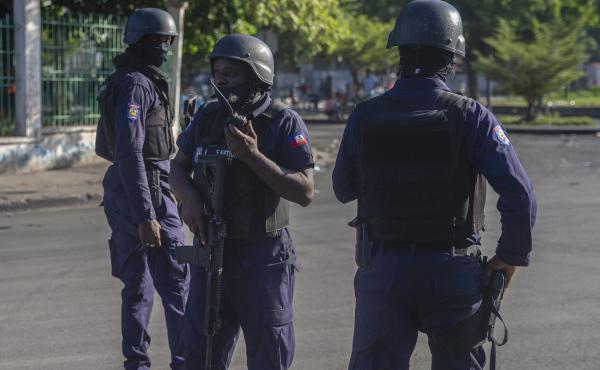 Armed forces secure the area where Haiti's prime minister, Ariel Henry, placed a bouquet of flowers in front of a memorial to independence hero Jean-Jacques Dessalines in Port-au-Prince, Haiti, on Sunday. Haitian police are working with U.S. officials and
