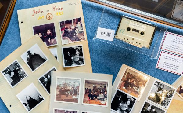 A cassette with the recording of teenage journalists' 1970 interview with John Lennon and Yoko Ono, along with polaroid photos from the conversation, seen at Bruun Rasmussen Auction House in Copenhagen on September 24, 2021. An unidentified bidder won the