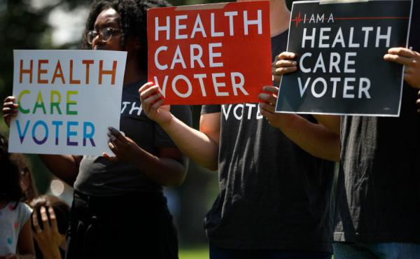 Demonstrators held signs outside the U.S. Capitol in Washington DC on June 26, 2018 while Democratic leaders called on the Trump administration to uphold the preexisting conditions provision of the Affordable Care Act. Now the issue may be decided in cour