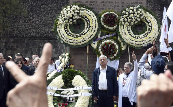 Mexican President-elect Andres Manuel Lopez Obrador, center, stands Tuesday with Ana Ignacia Rodríguez Marquez, a former leader of the student movement of 1968, at a ceremony marking the 50th anniversary of the 1968 Tlatelolco massacre, at the Tres Cultu