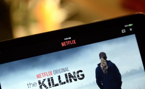 A screen shows a Netflix series, The Killing.