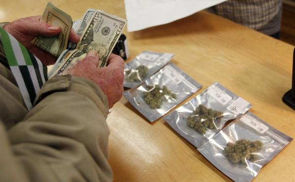 A customer buys marijuana at Harborside dispensary in Oakland, Calif., on Monday.