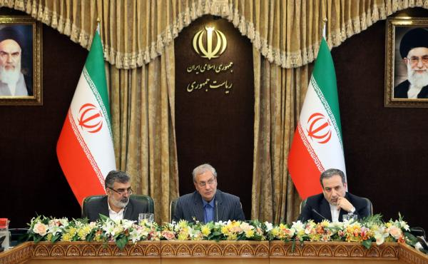 From left: Iran's Atomic Energy Organization spokesman Behrouz Kamalvandi, government spokesman Ali Rabiei and Deputy Foreign Minister Abbas Araghchi give a joint press conference at the presidential headquarters in the capital Tehran on Sunday. Iran is e