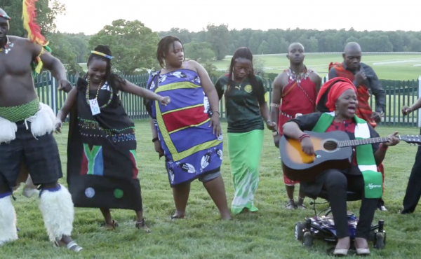 """Grace Jerry performs her original single """"E Go Happen"""" at a gathering of young African leaders at Montpelier, James Madison's home. The lyrics say: """"Yes we can, sure we can change the world."""""""