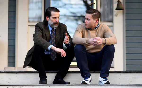 Dr. Lee Goldstein, Associate Professor of Psychiatry, Neurology, Ophthalmology, Pathology and Laboratory Medicine, & Biomedical Engineering at Boston University and Newton North High School Football player Alex Riviero speak on the front porch of Dr. Gold