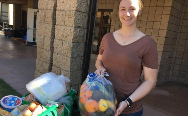 Kara Dethlefsen, an active-duty Marine, attends the monthly food pantry at the Camp Pendleton Marine Corps Base near San Diego. Her husband is also a Marine. She says the food assistance is helping them get ready for his transition back to civilian life.