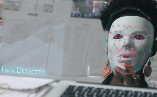 Image of a black woman wearing a white face mask.