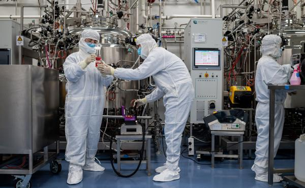 Engineers work on a potential vaccine for the coronavirus at a Beijing lab.