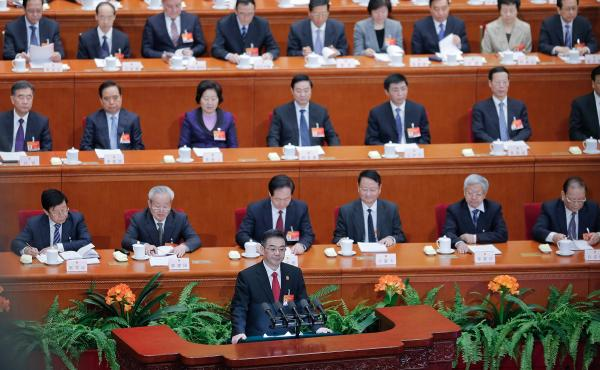 Zhou Qiang, president of the Supreme People's Court of China, speaks to the National People's Congress in Beijing on March 12. Chinese authorities are waging a major campaign against corruption, and that includes a list of 100 suspects believed to be over