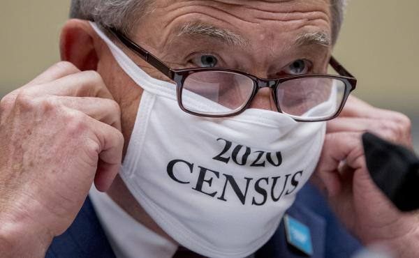 "Census Bureau Director Steven Dillingham, wearing a face covering printed with the words ""2020 Census,"" testified before the House oversight committee Wednesday that the bureau plans to finish counting ""as soon as possible"" despite career officials previo"