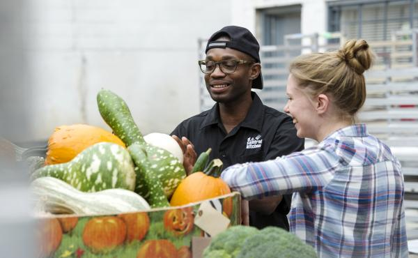 Student volunteers with The Campus Kitchens Project evaluate produce. The initiative gets high-school and college students to scavenge food from cafeterias, grocery stores and farmers' markets, cook it and deliver it to organizations serving low-income pe