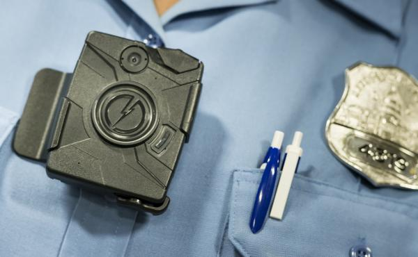Body cameras, like this one shown at a 2014 press conference in Washington, D.C., are small enough to be clipped to an officer's chest. Washington and Denver are among U.S. cities trying the cameras.