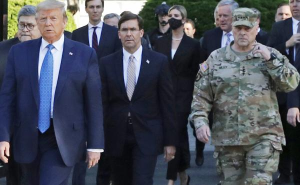 "President Trump walking from the White House to St. John's Church on June 1. Gen. Mark Milley (far right), chairman of the Joint Chiefs of Staff, was among those walking behind the president. Milley says his presence was ""a mistake"" that he has learned fr"