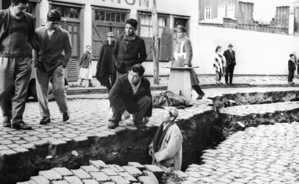 Residents of Valdivia, Chile, inspect an enormous crack caused by the Great Chilean Earthquake on May 22, 1960.