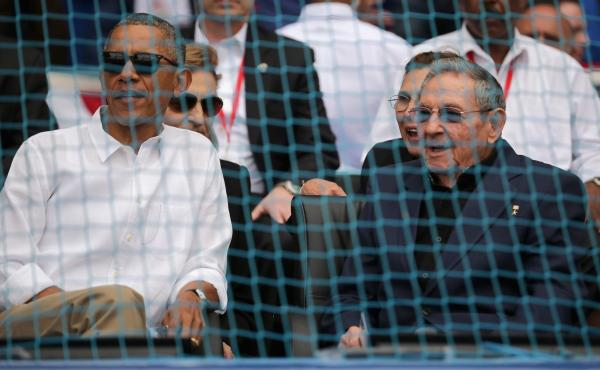 President Obama and Cuban President Raul Castro attend a baseball game during Obama's visit to Havana on March 22. The U.S. has opened up to a number of longtime foes in recent years, including Cuba. This has raised a debate about whether this leads to im