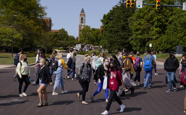 As students return to college campuses, the surrounding communities are seeing an increase in coronavirus infections.