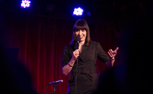 Ophira Eisenberg performs on stage on Ask Me Another at the Bell House in Brooklyn, New York.