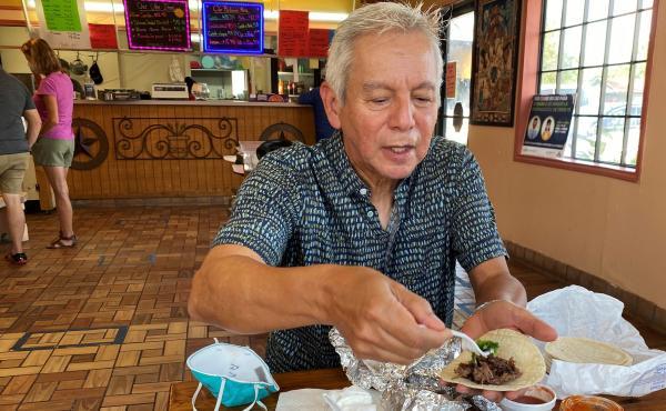 Adán Medrano, chef and food writer, savors a beef cheek taco at Vera's Backyard Bar-B-Que in Texas' Rio Grande Valley.