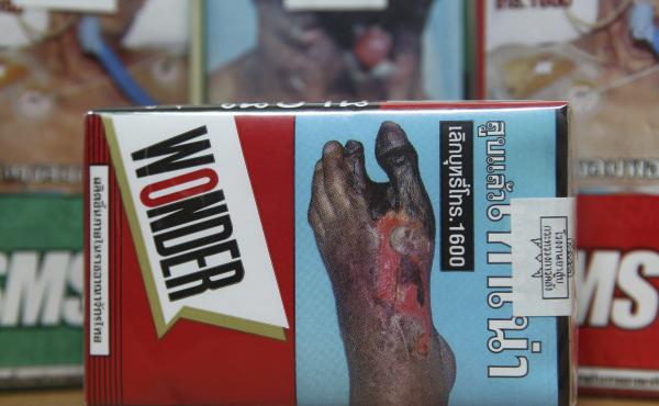 This notice on a cigarette packet in Thailand shows the potential impact of reduced blood circulation to extremities because of smoking. Such pictorial warnings are among the anti-smoking measures that are more likely to be found in countries that have li