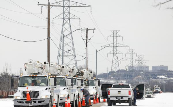 FORT WORTH, TX - FEBRUARY 16: Pike Electric service trucks line up after a snow storm on February 16, 2021 in Fort Worth, Texas. Winter storm Uri has brought historic cold weather and power outages to Texas as storms have swept across 26 states with a mix