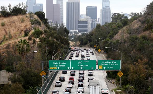 Cars make their way toward downtown Los Angeles on April 22. California could regain the right to set its own vehicle emissions standards after the Environmental Protection Agency announced it was moving to curb a Trump-era policy that sought to erode the