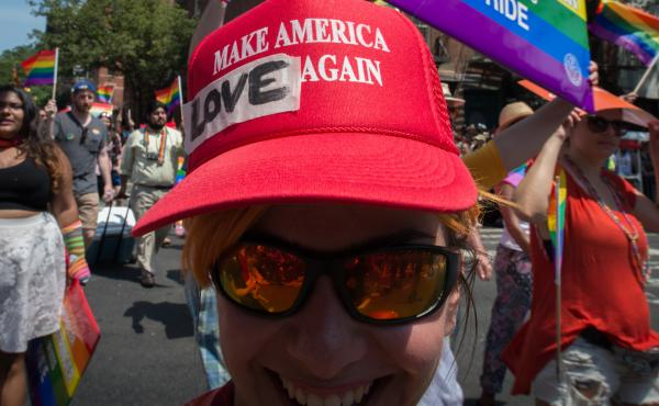 President Trump has decided to leave in place President Barack Obama's 2014 executive order protecting employees from anti-LGBTQ workplace discrimination while working for federal contractors. Here, a marcher in New York's Gay Pride march wears a modified