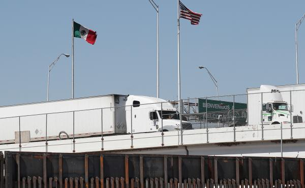 Trucks are seen heading into the United States from Mexico along the Bridge of the Americas in El Paso, Texas, on Tuesday. U.S. industries say President Trump's threatened tariffs on goods from Mexico raised uncertainty just as they were looking forward t