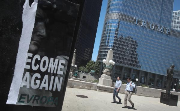 """A defaced recruiting flyer for Identity Evropa hangs near Trump Tower in Chicago, in July 2016. The flyer which read """"Let's Become Great Again"""" was part of a 17-city recruitment effort by the white nationalist organization."""