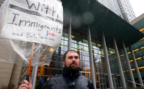 Patrick Wicklund, from Seattle, stands outside the U.S. District Court, Western Washington, on Feb. 3, 2017 in Seattle, Washington. Washington state Attorney General Bob Ferguson filed a state lawsuit challenging key sections of President Trump's immigrat