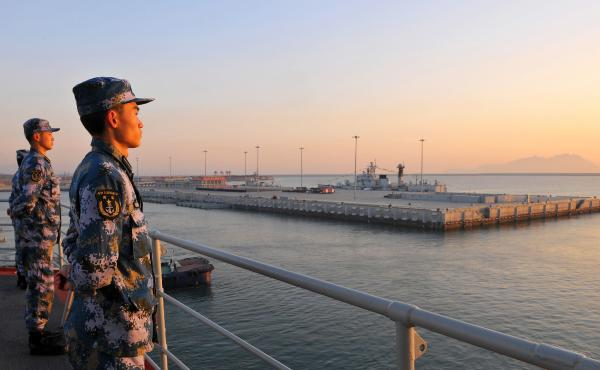 Members of the Chinese navy stand guard on China's first aircraft carrier, Liaoning, in this 2013 photo. Tensions in the South China Sea have grown over territorial disputes between China, the Philippines, Japan, Vietnam and others.