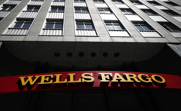 A Wells Fargo Bank branch office in San Francisco. The bank acknowledges it signed up nearly 500,000 auto-loan customers for insurance they didn't need.