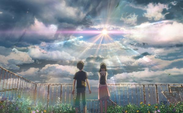 In writer/director Makoto Shinkai's latest animated feature, Hodaka (voiced by Kotaro Daigo, L) meets Hina (voiced by Nana Mori, R), a girl who can stop the rain.