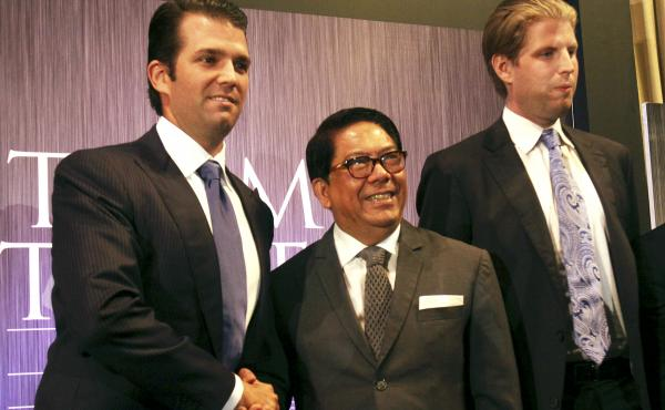 Donald Trump Jr. (left) and Eric Trump (right), sons of President-elect Donald Trump, pose with Philippine real estate developer Jose E.B. Antonio at a 2012 news conference in Manila announcing the launch of the Trump Tower Manila, a $150 million project