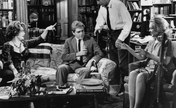 Elizabeth Taylor, (from left) George Segal, Richard Burton and Sandy Dennis starred in the 1966 film adaptation of Edward Albee's play, Who's Afraid of Virginia Woolf? A theater director in Portland recently cast an African-American actor as Nick (Segal's