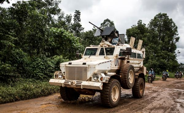 A U.N. military truck patrols on the road linking Mangina to Beni, the current epicenter of the Ebola outbreak in Democratic Republic of the Congo.