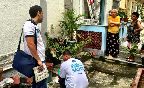 Health inspectors collect samples of mosquito larvae from standing water in a garden in a middle-class neighborhood in the north of Rio de Janeiro. They are searching for places where the Aedes aegypti mosquito breeds — that's the one that carries Zika