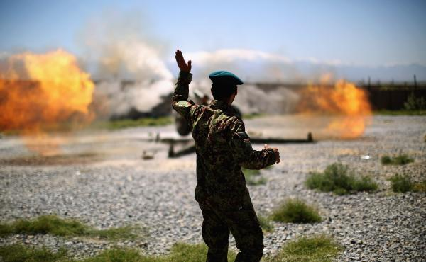 A member of the Afghan army looks on as an artillery gun fires at Taliban fighters in the hills of Nangahar Province, in eastern Afghanistan, in 2015. NPR photographer David Gilkey, who was killed Sunday, embedded with the Afghan military on multiple occa
