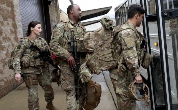 U.S. Army soldiers board a bus in January 2020 at Fort Bragg, N.C., one of the military bases that will likely see population boosts in their 2020 census counts due to a change to how troops deployed abroad were counted.