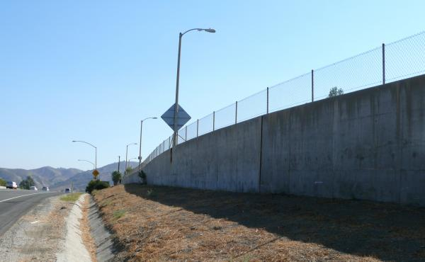 The proposed overpass would allow mountain lions to cross this section of freeway. One mountain lion was hit near here after apparently failing to make it over this wall.