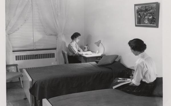 Two roommates in the 1950s study in their Duke University dormitory. The school has decided to bring back largely random roommate pairings.