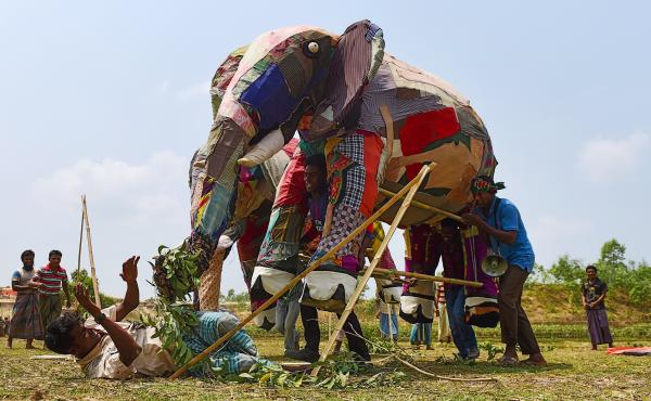 Rohingya refugees use a mock elephant during a training session on how to respond to elephant incursions at the Kutupalong refugee camp. The massive refugee camp sits in what used to be a migratory path for elephants moving between Myanmar and Bangladesh.