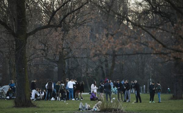 Young people gather in the Volkspark am Friedrichshain in Berlin on March 18. Germany's fatality rate so far — just 0.5% — is the world's lowest, by a long shot.