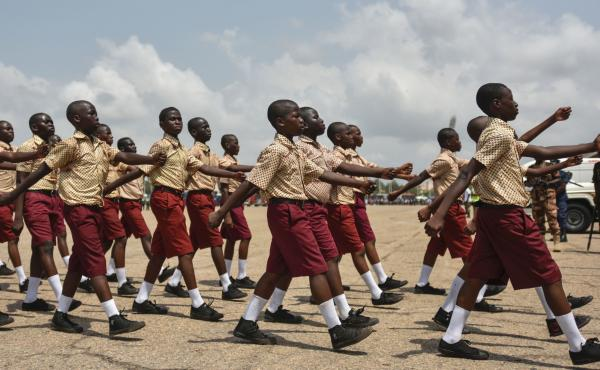 Students march during the celebration of Ghana's 60 years of independence on March 6 in Accra.