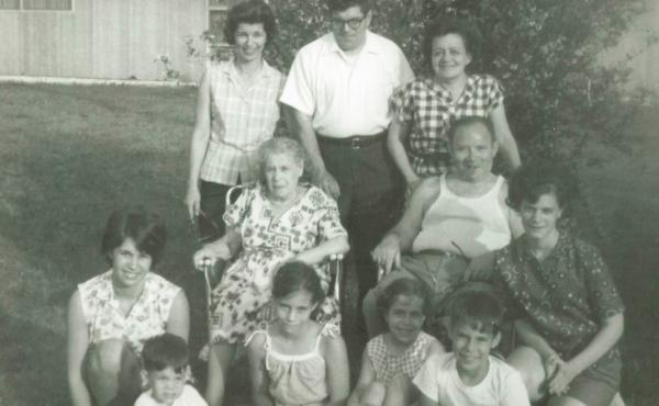 Howard Berkes (seated, front row right) volunteered to be part of a COVID-19 research study this year. He says his family, photographed here in the 1960s, had a history of stepping up during difficult times. That includes his grandparents (in middle), who
