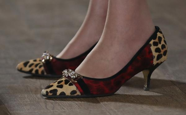 Theresa May, who will be Britain's next prime minister, often attracts media attention for her choice of footwear. She was wearing these leopard-print shoes at an event Monday in Birmingham, England.